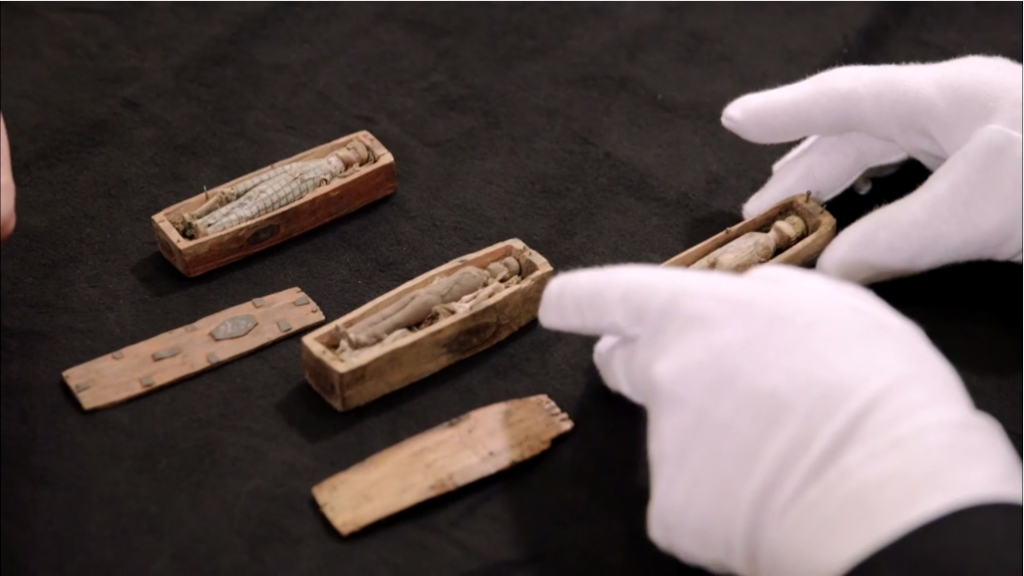 Tiny wooden dolls inisde tiny wooden coffins might be connected to notorious Edinburgh grave robbers and murderers Burke and Hare.