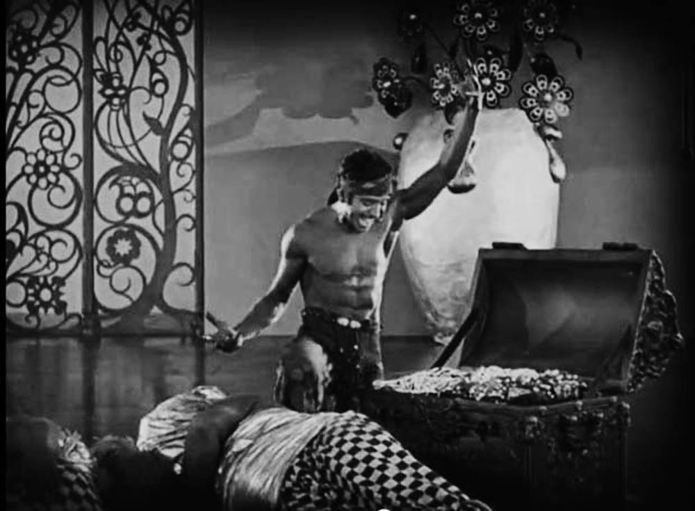 """Ah ha! Treasure!"" Douglas Fairbanks as the thief, in The Thief of Bagdad, a silent film from 1924."