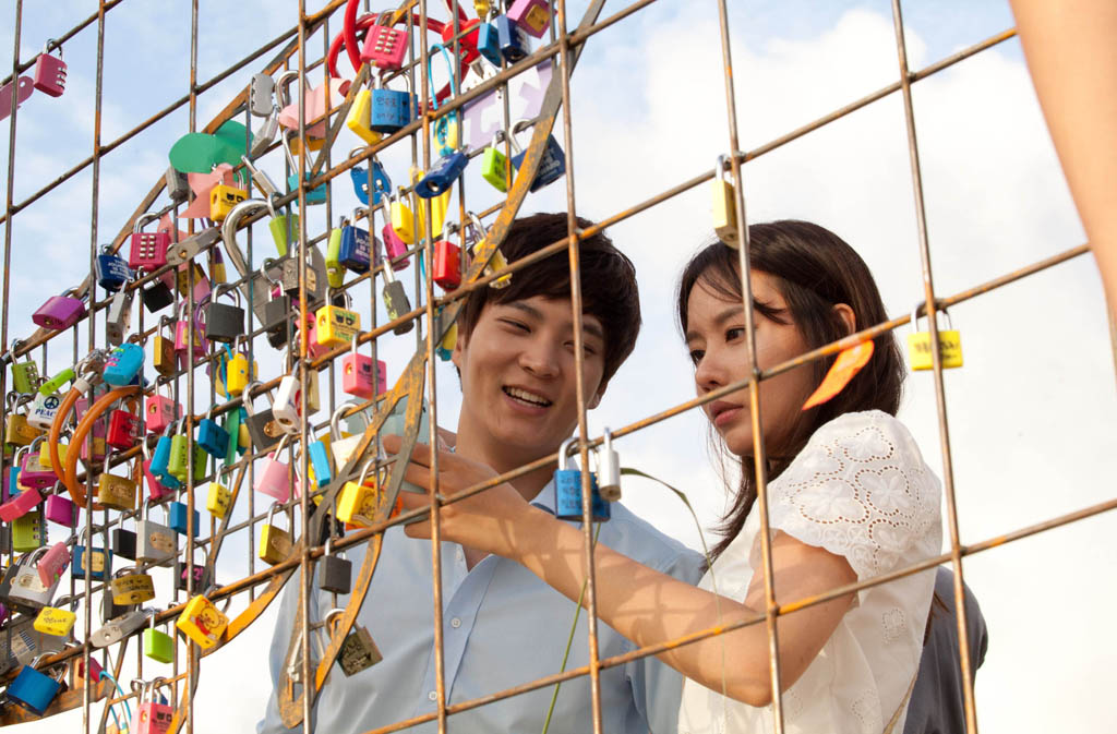 "Joo Won, left, and Kim Ah-joong examine ""love locks"" in the Korean romantic comedy Catch Me (Steal My Heart)."