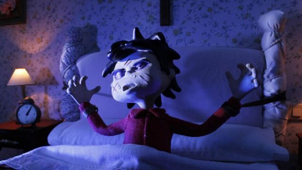 Damian is possessed. He needs an exorcist! Scene from the Spanish claymation film Possessed (Pos eso) one of sveral animated films being shown at the 2015 Fantasia International Film Festival in Montreal.