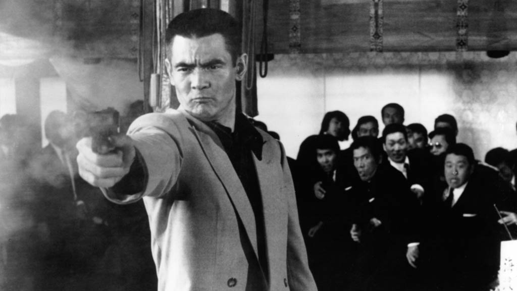 Bunta Sugawara as a gangster in the 1973 Japanese film Battles Without Honor and Humanity, which is being shown at the 2015 Fantasia Film Festival.