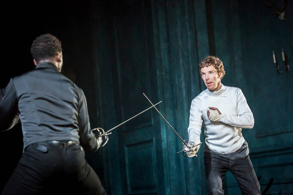 Benedict Cumberbatch as Hamlet at the Barbican Theatre in London. Here he's clasing with Kobna Holdbrook-Smith as Laertes. (Photo by Johan Persson)sword fighting