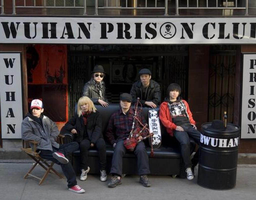 Wu Wei, standing, centre rear, with his fellow punk musicians outside his bar in Wuhan, China. Note the bagpipes! The history of Chinese punk music is explored in the documentary Never Release My Fist, by Shuibo Wang.