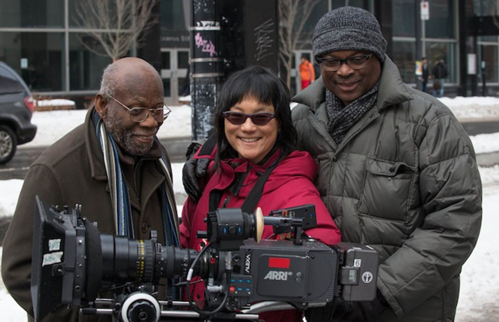 Concordia professor Clarence Bayne (left), director Mina Shum and producer Selwyn Jacob across the street from the Henry F. Hall Building of Concordia University. (National Film Board of Canada photo.)