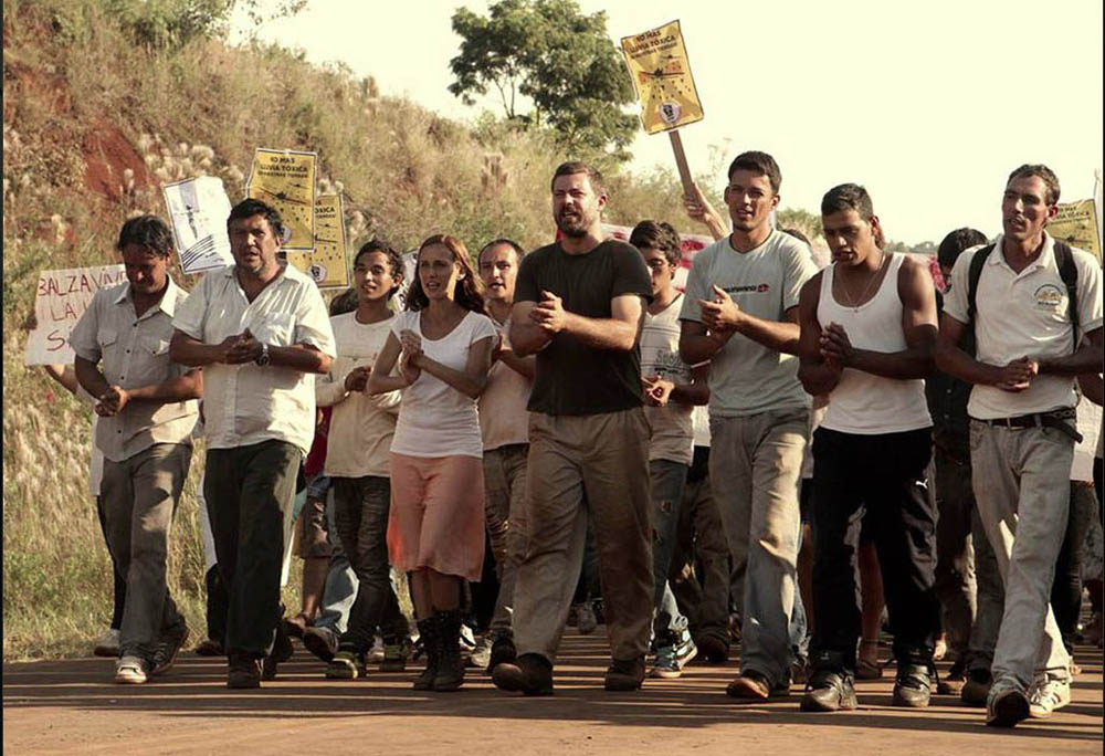 Ana (Eugenia Ram'rez Miori, in the orange skirt) and Pierre (Geert Van Rampelberg, in the black T-shirt) take part in a march against the use of toxic chemicals and the oppression of workers, in the film La Tierra Roja. It's a co-production between Belgium and Argentina that's being shown as part of the Festival du nouveau cinema.