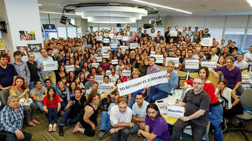 Employees of the newspaper La Nacion in Buenos Aires, Argentina, want everyone to know that they do not agree with an editorial printed on Monday, Nov. 23, 2015, that suggested it was time to stop prosecuting people who committed murder and other human rights abuses during Argentina's Dirty War, between 1976 and 1983. (La Nacion photo)