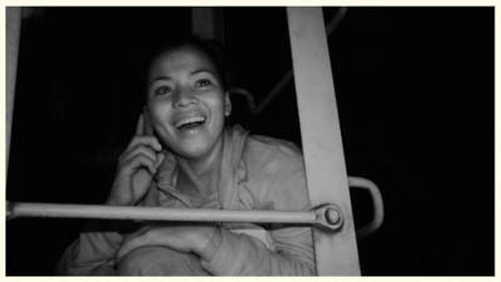 In this scene from the documentary film LlŽevate mis amores (All of Me), a Central American migrant is able to call her mother, thanks to the helpful women known as Las Patronas.