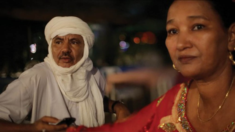Malian musician Fadimata Walett Oumar, who is nicknamed Disco, right, and her husband Hassan (Jimmy) Mehdi, in a scene from the documentary film They Will Have To Kill Us First: Malian Music in Exile. The film is being shown at RIDM, Montreal's documentary film festival.