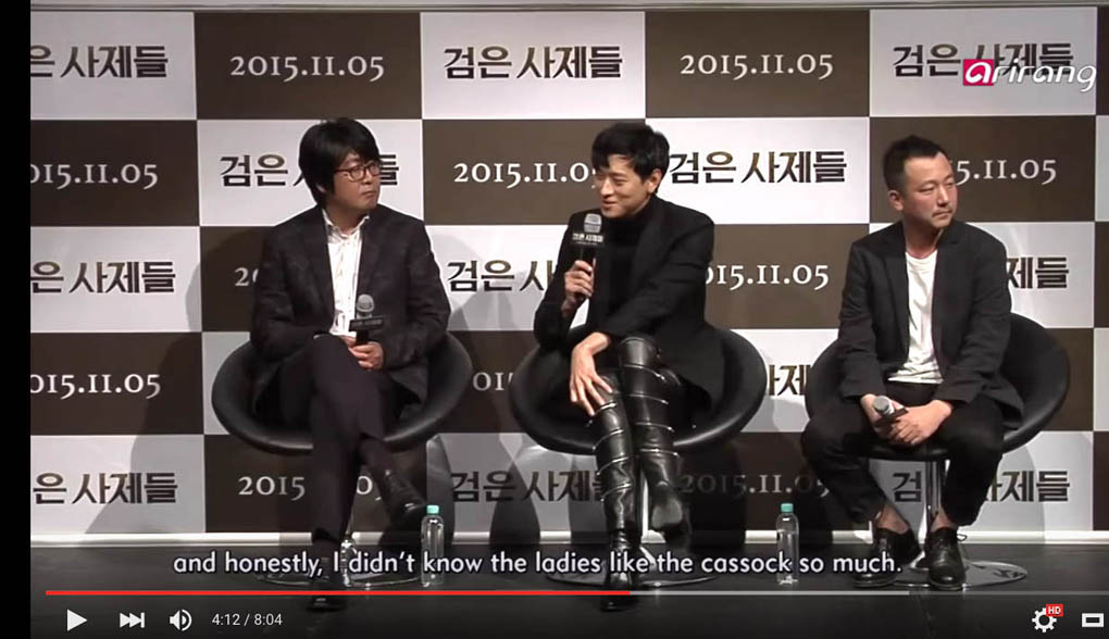 In a screen grab from an interview on Korean TV, actor Kang Dong Won talks about wearing a cassock, while praying the role of a seminary student, in the film The Priests.