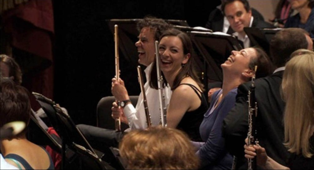 Members of the Royal Concertgebouw Orchestra share laughs in a scene from Around the World in 50 Concerts. The documentary by Heddy Honigmann is the January selection for RIDM+, an offshoot of Montreals RIDM film festival.