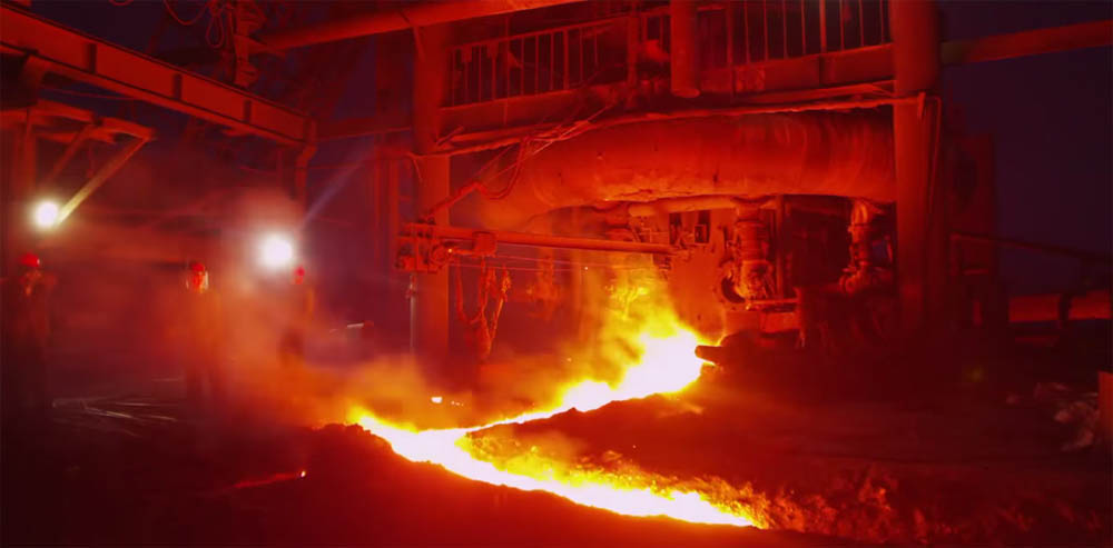 Foundry employees work with molten metal in Zhao Liang's documentary film Behemoth.