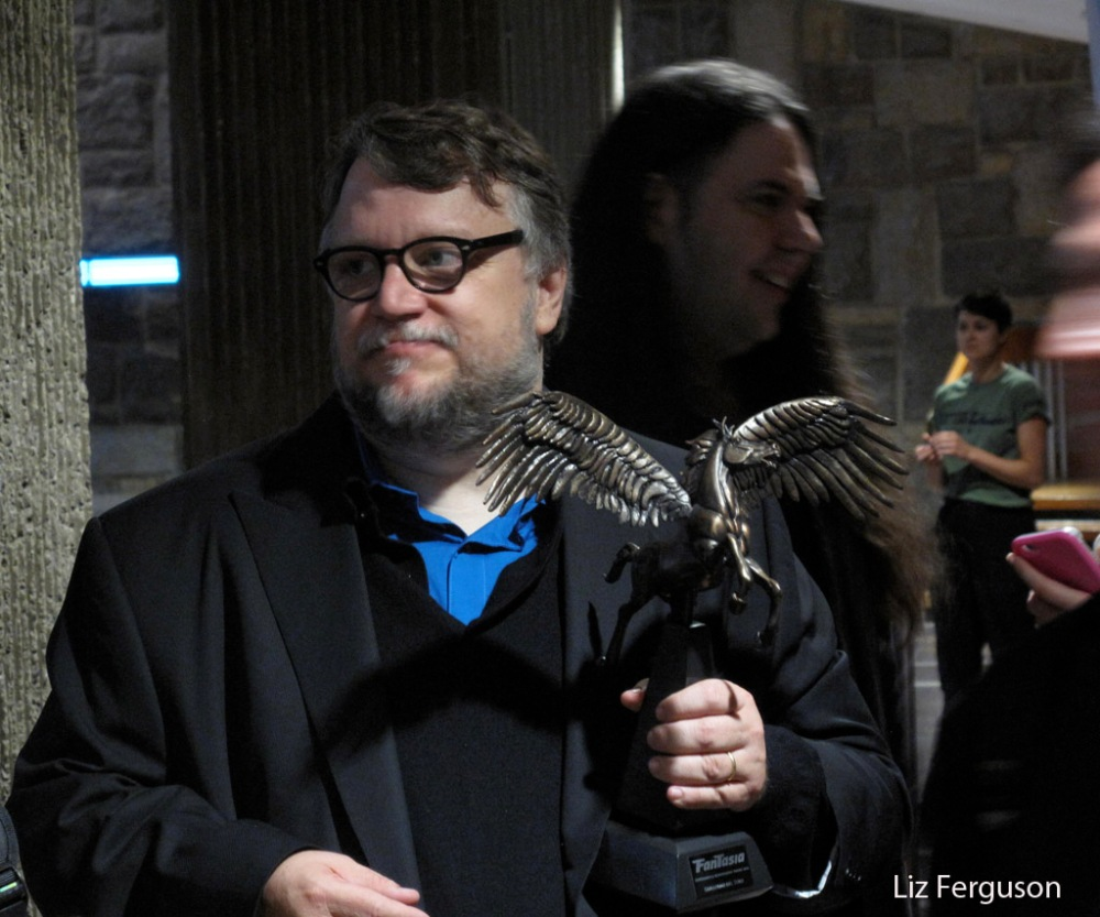 Director Guillermo del Toro with his Cheval Noir Award at the Fantasia International Film Festival in Montreal, Friday, July 15, 2016. The smiling guy behind Del Toro is festival programmer Mitch Davis. (Liz Ferguson photo)