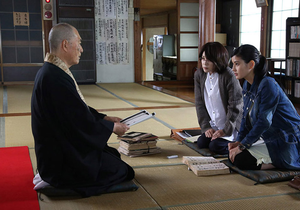 A writer (Yuko Takeuchi) and a student (Ai Hashimoto) seek information from a Buddhist priest in the Japanese film Inerasable, directed by Yoshihiro Nakamura. Inerasable is being shown at the Fantasia International Film Festival in Montreal.