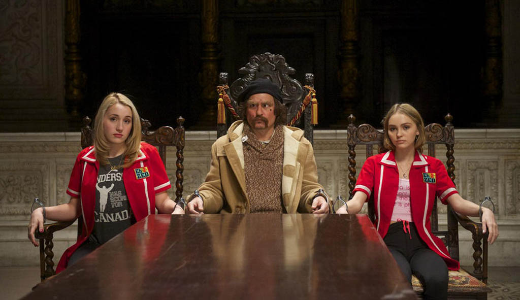 Colleen M (Harley Quinn Smith) left, Guy Lapointe (Johnny Depp) centre, and Colleen C are held prisoner in a secret, underground lair in Kevin Smith's film Yoga Hosers.