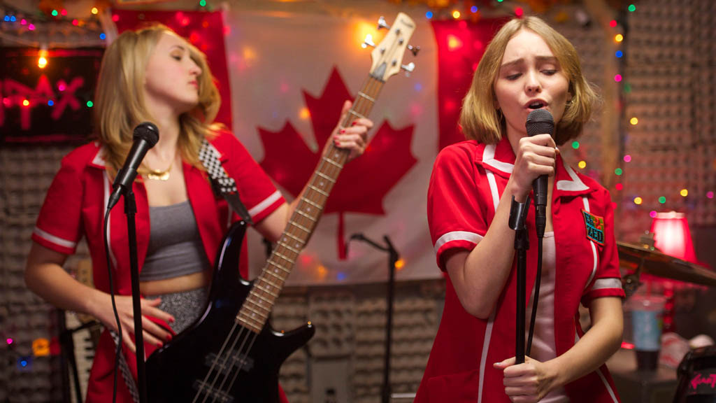 Harley Quinn Smith, left, and Lily-Rose Melody Depp give a decent rendition of O Canada during the closing credits of Kevin Smith's film Yoga Hosers. Depp even sings some of the French verses.