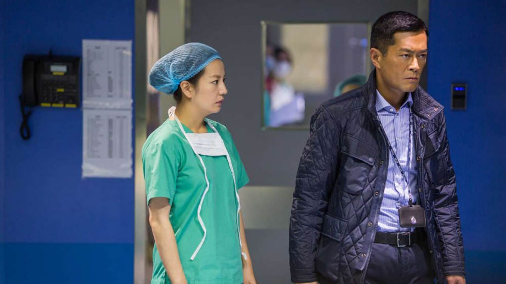 Vicki Zhao Wei plays a neurosurgeon and Louis Koo plays a police detective in Three, a film from Hong Kong director Johnnie To. Koo wears that same stone-faced look in 98 per-cent of the film.