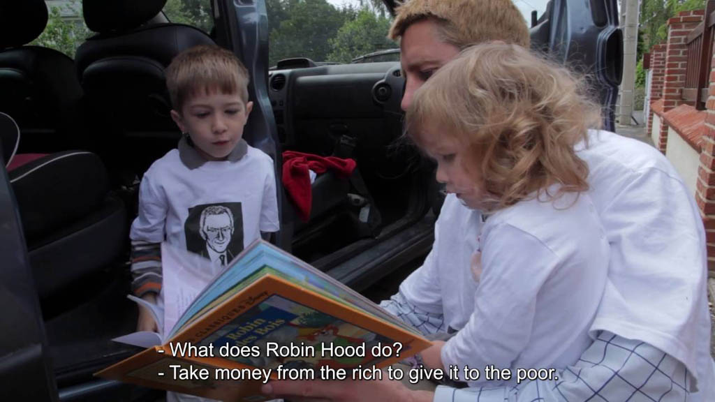 In this screen grab from the French documentary Merci Patron!, director Franois Ruffin reads a Robin Hood story to his children. Merci Patron is being shown at the Festival du nouveau cinŽma in Montreal.