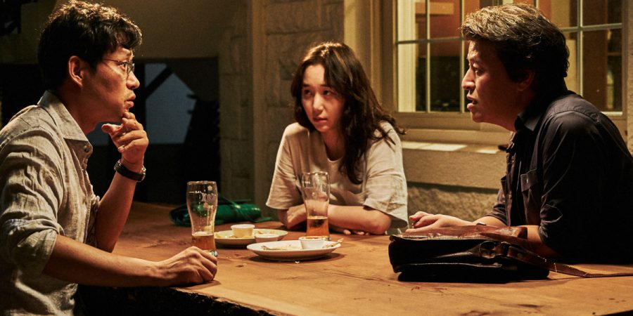 Lee You-young, centre, as Minjung, with two of her drinking buddies, in the Hong Sang-soo film Yourself and Yours.