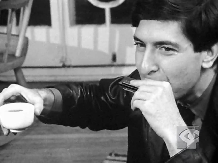 Caffeine and music! Two of life's essentials. Leonard Cohen with coffee and a harmonica, in a shot from the 1965 NFB documentary film, Ladies and Gentlemen. . .Mr. Leonard Cohen.