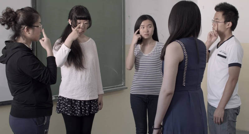"In a scene from the hybrid documentary El Futuro Perfecto, Zhang Xiaobin, centre, and her fellow students in a Spanish language class prove that they understand the meaning of the word ""ojos."""