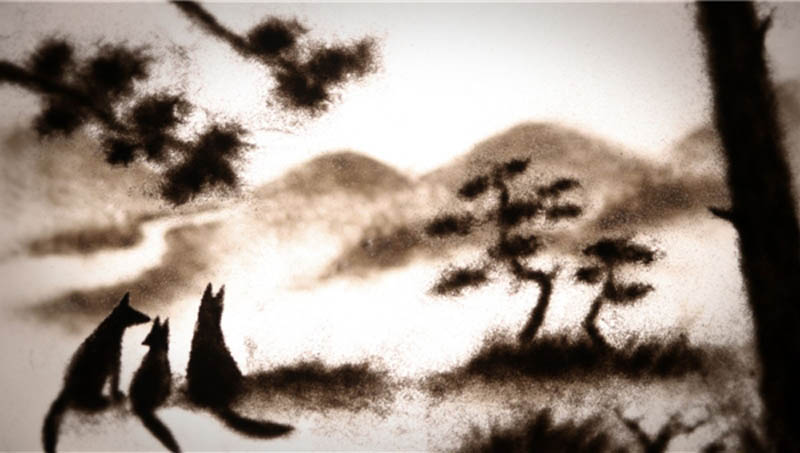 A fox family in sihouette in the animated film Japanese Fox Fears. Director Miya Sato created the images using sand and paint on glass.