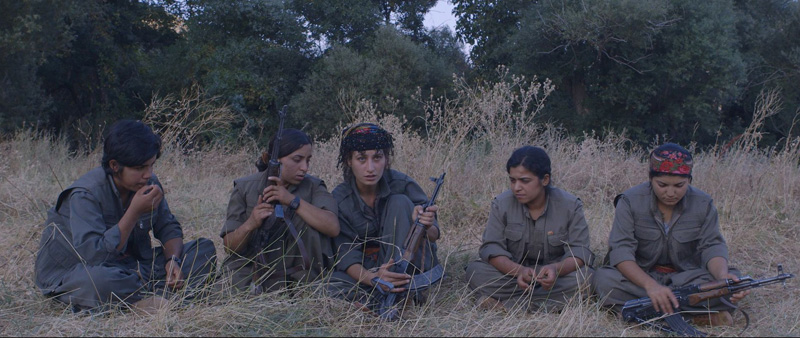 Rojen Beritan, centre, is one of many Kurdish women who are fighting against the Islamic State.